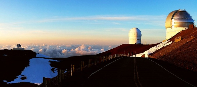 Image Description: Three observatories atop Mauna Kea. Photo credit: Public Domain.